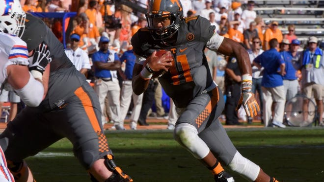 Tennessee quarterback Joshua Dobbs (11) run during first half action against Florida Saturday, September 24, 2016 at Neyland Stadium in Knoxville, Tenn.
