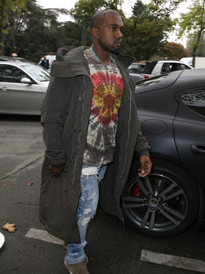 Kanye West arrives to attend the Celine show as part of the Paris Fashion Week Womenswear Spring/Summer 2014 on Sept. 29, 2013 in Paris.
