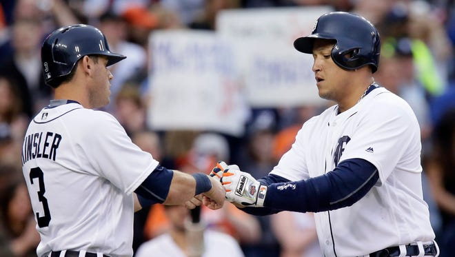 Miguel Cabrera #24 of the Detroit Tigers is congratulated by Ian Kinsler #3 of the Detroit Tigers after hitting a two-run home run to tie the game at 3-3 during the third inning at Comerica Park on May 20, 2016 in Detroit, Michigan.