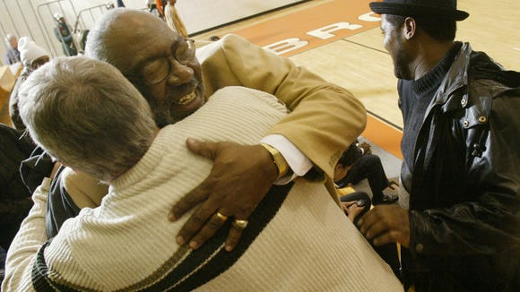 2/27/04.  Bill Smith facing camera gets a hug from Tom Kleinschmidt as Rick Jones stands at right.  Both Kleinschmidt and Jones are former players of Smith and graduated Broad Ripple HS in the seventies.  Smith is retiring after a long career coaching Broad Ripple Boy's basketball.  Before game with Gary's Roosevelt HS.  BRHS.  (Robert Scheer Photo) w/story file 94435