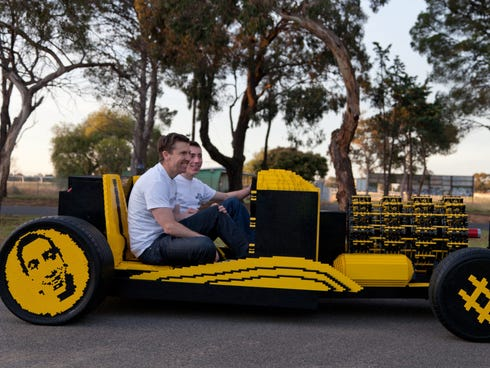Entrepreneur Steve Sammartino, left, and Raul Oaida take their Lego car on a test drive.