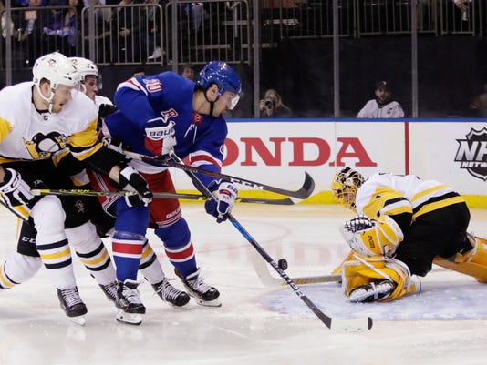 Pittsburgh Penguins goaltender Casey DeSmith (1) stops a shot on goal by New York Rangers' Chris Kreider (20) during the second period of an NHL hockey game Wednesday, March 14, 2018, in New York. (AP Photo/Frank Franklin II)