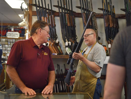 Gary's Gun Shop owner Steve Naatjes, left, and gun