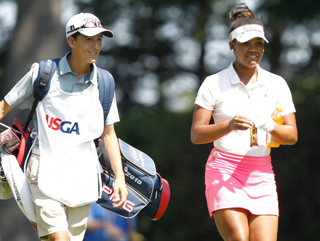 Kyra Cox, 16 from South Salem, with caddie Jacob Gonzalez, walks down a fairway in the 68th U. S. Girls Junior Amateur Championship at The Ridgewood Country Club in Paramus on Monday, July 18, 2016. Kyra Cox recently played in the 2016 Drive, Chip & Putt National Championship at Augusta National and was the Metropolitan PGA Player of the Year three consecutive times from 2013 to 2015.