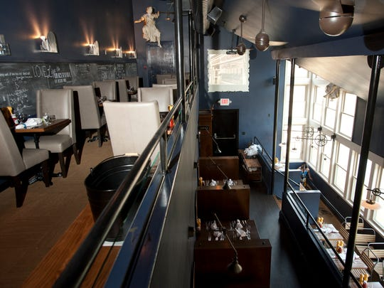 The Lobby Restaurant and Bar in downtown Middlebury features a casual and eclectic dining atmosphere with multi-level dining complete with cozy booths and upholstered two-tops with chalkboard walls featuring quotes by both guests and the restaurant.