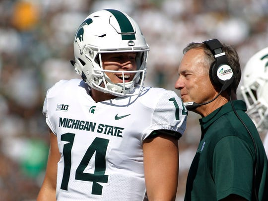 Michigan State quarterback Brian Lewerke and coach Mark Dantonio react after Lewerke's 61-yard touchdown run against Western Michigan, Sept. 9, 2017 in East Lansing.