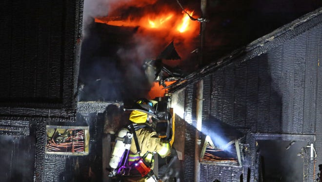 Kent firefighters battle a fire that caused considerable damage to a home in White Pond Colony late Tuesday night Jan. 19, 20016. Firefighters from Lake Carmel, Carmel, Putnam Valley and Mahopac assisted Kent at the scene.