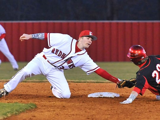 Creek Wood shortstop Jamey Williams puts the tag on Hickman County's Bryan Garren. Creek Wood vs Hickman County.