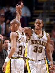 The Indiana Pacers Antonio Davis (33) celebrates with Reggie Miller after hitting a bucket and getting the foul.  (STAFF PHOTO/PAUL SANCYA)
