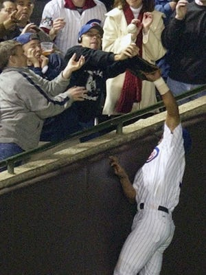 Steve Bartman, in the stands, tipped this ball on Oct. 14, 2003 as Cubs outfielder Moises Alou tried to make the catch.