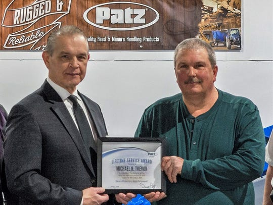 Darrell Patz, president of Patz Corporation, congratulates