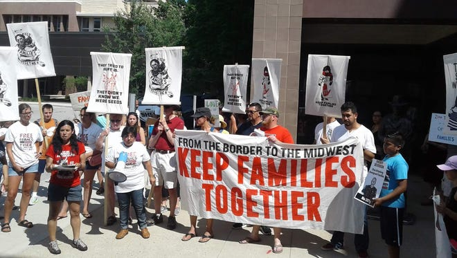Demonstrators gather outside the Waukesha County Sheriff's Office at the courthouse on June 30 to protest the county's involvement in the federal 287g immigration control enforcement initiative. The Waukesha protest was part of a broader national protest on immigration issues tied to the Trump Administration.