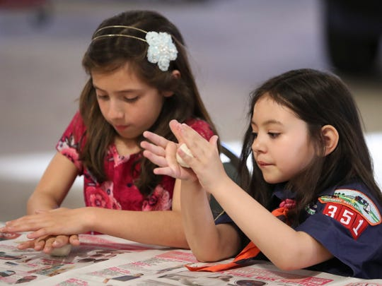 "Isabel Barrera (left) and Alexandra ""A.J."" Gardner, both of Middletown, work on a project at their Cub Scout pack meeting at the Townsend Fire Company station."