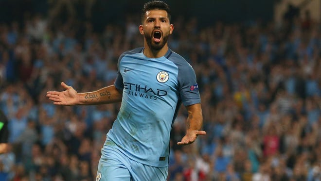 Manchester City's Sergio Aguero celebrates after scoring his team's third goal.