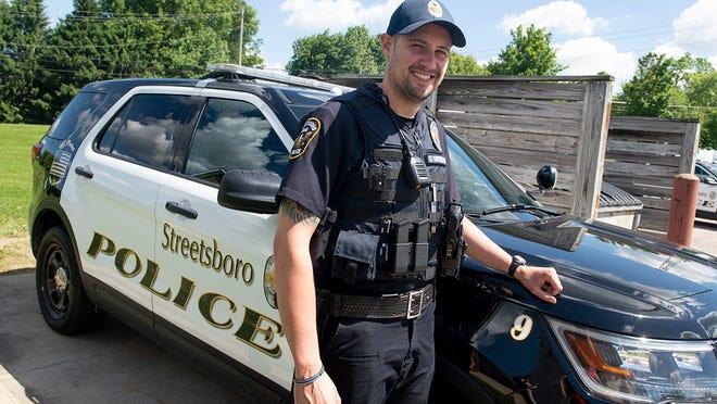 Streetsboro patrol officer Stanley Siedlecki stands outside of his Streetsboro Police cruiser.