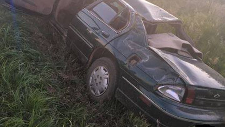 The driver of a car that rolled into a ditch was left