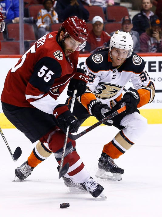 Arizona Coyotes defenseman Jason Demers (55) tries to keep the puck away from Anaheim Ducks right wing Jakob Silfverberg (33) during the first period of an NHL hockey game Saturday, Feb. 24, 2018, in Glendale, Ariz. (AP Photo/Ross D. Franklin)