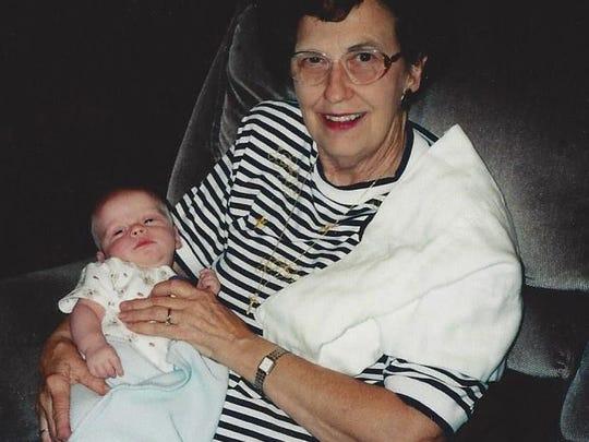 Tommy Dean Hearne holds her grandson, David Halbrook,