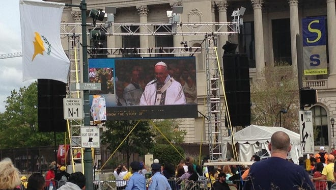 Pope Francis is seen Sept. 26 speaking on the Jumbotron in front of the Basilica of Saints Peter and Paul in Philadelphia.