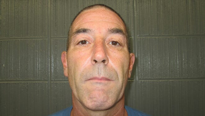 Richard Darter, 50, of Cutler, surrendered Monday, Oct. 12, 2015 in response to an arrest warrant that had been issued Friday. Darter is the owner of four pit bull terriers that attacked two women Oct. 1.