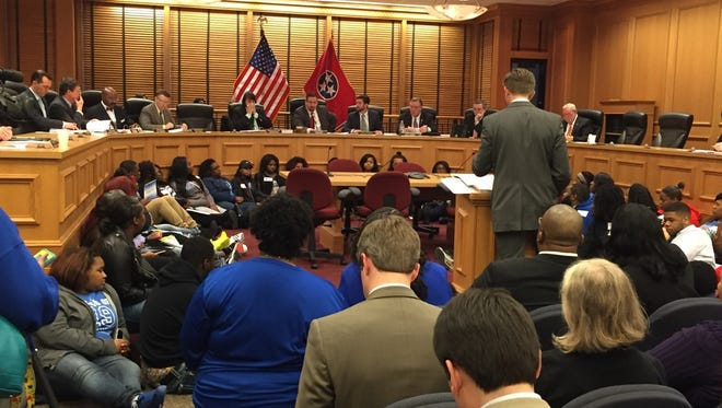 Tennessee State University students pack a hearing room to protest Gov. Bill Haslam's college plan.