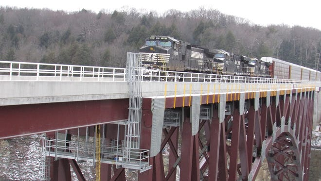 A train crosses the new railroad bridge over the Genesee River Gorge in Letchworth State Park.