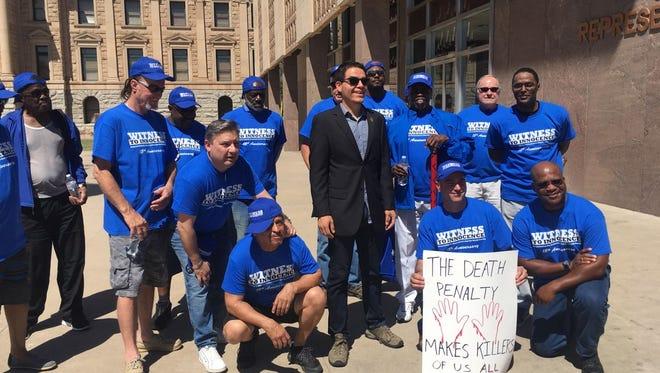 State Senator Juan Mendez stands with Witness to Innocence exonerees