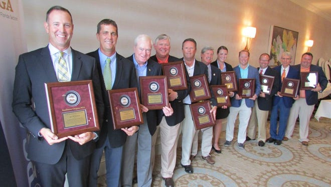 Southwest Chapter PGA award winners pose with their plaques on Monday, May 14, 2018, at Heritage Palms Golf & Country Club in Fort Myers.