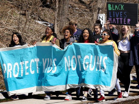 About 200 Shorewood students marched along North Lincoln Memorial Drive on April 20 on the 19th anniversary of the Columbine school shooting. They were later joined by Rufus King High School and other MPS students for a lakefront park rally, before marching to UW-Milwaukee for peace building and social justice workshops.