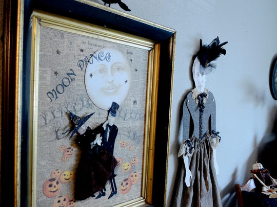 Kohley uses paper dolls in framed pieces and, new this year, as nearly 4-foot wall hangings.