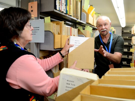 Charlien Tice, left, and Jerry Rodgers, both volunteers with the Willamette Valley Genealogical Society, sorts through materials in the stacks at the Oregon State Library in Salem on Friday, Oct. 24, 2014. The WVGS is working to move all its resources to the Salem Public Library, a process that will take months.