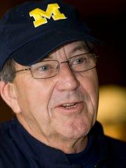 Former Michigan football coach Lloyd Carr speaks to