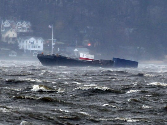 One of two barges spotted floating downriver in the Hudson, as seen from Irvington, south of the Gov. Mario M. Cuomo Bridge on Friday, March 2, 2018. The barges broke free during a powerful nor'easter that brought rain, snow and severe wind to much of the Mid-Atlantic and Northeast.