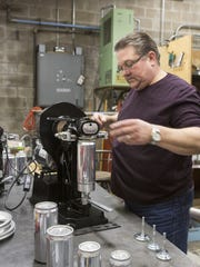John Henfer demonstrates how the automatic canning