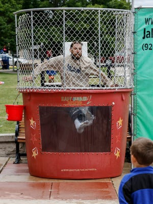 Alderman Jeremiah Novak gets sunk in the dunk tank during Manitowoc Public Library's first-ever Carnival Day Friday, Aug. 4, 2017, in Manitowoc, Wis. The event celebrates the end of the library's Summer Reading Program. Josh Clark/USA TODAY NETWORK-Wisconsin