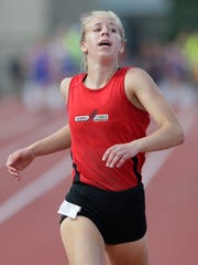 Newman Catholic's Julianne Barkholz captured state titles in the 200 and 400 meters and the long jump over the weekend at the WIAA state track and field meet in La Crosse.