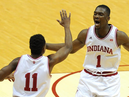 Indiana forward Noah Vonleh and Yogi Ferrell celebrate after a made jump shot against Wisconsin.