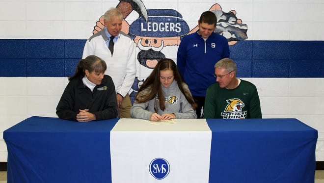 St. Mary's Springs basketball standout Emily Mueller signed a letter of intent last week to attend Northern Michigan University next fall.