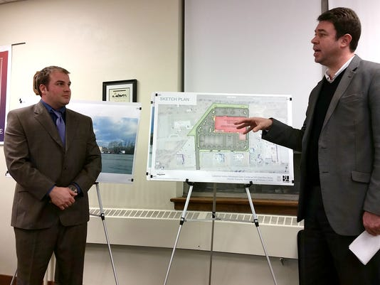 Greg Holtzman, left, of BL Companies, and Tom Stoessel, senior vice president of PinnacleHealth, discuss a proposed medical facility at the site of the Annville East Center during the Annville Township commissioners meeting Monday night. Brad Rhen -- Lebanon Daily News