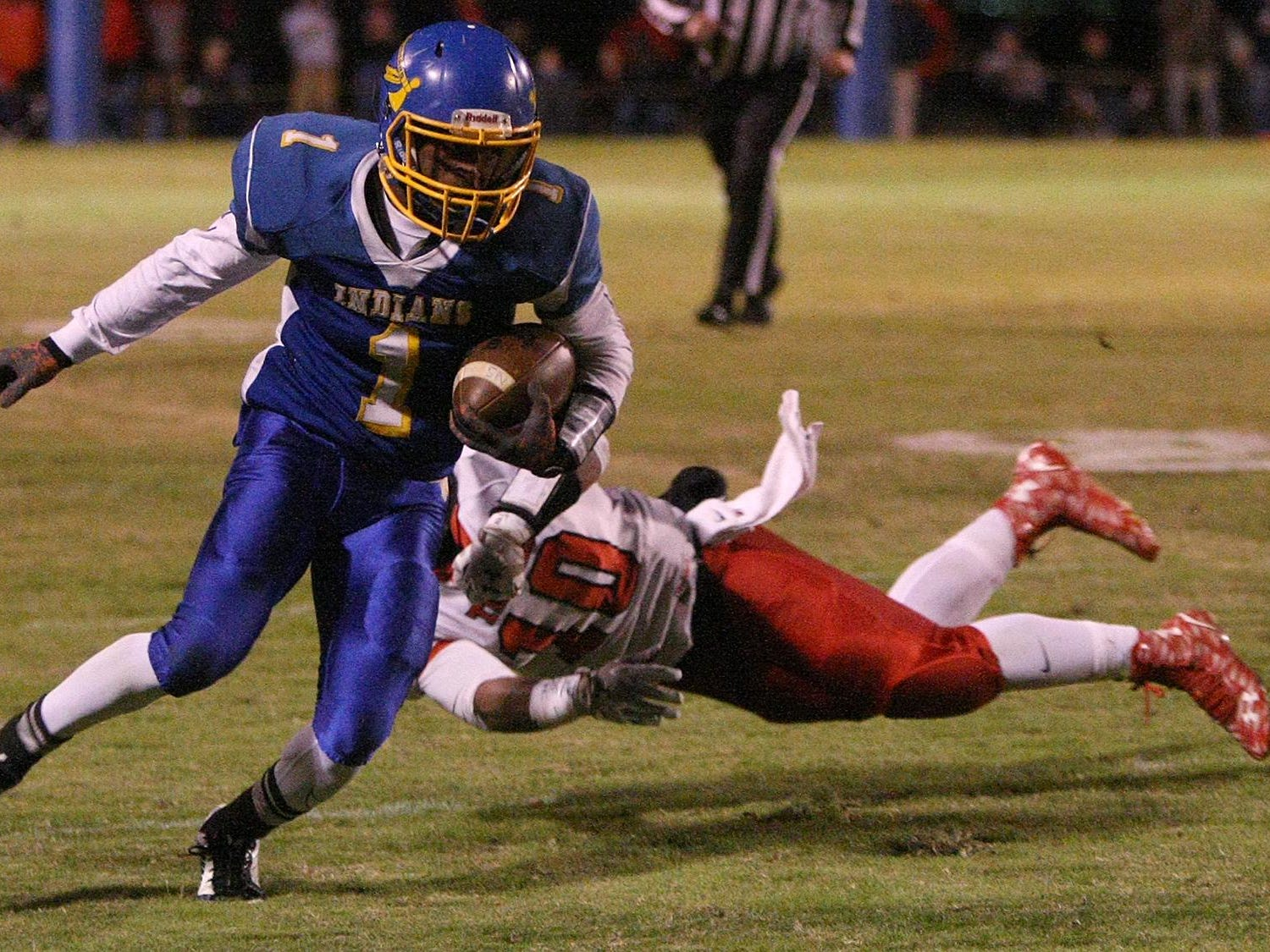 North Side's Darius Brown (1) sheds a tackle from Lexington's Darrius Bomer (10) at North Side High School on Friday.