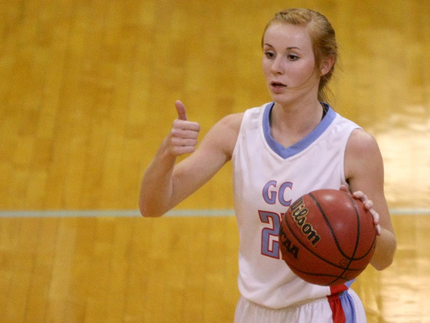 Gibson County's Allie Smithson (21) signals to her teammates against Westview at Bo Booth Gymnasium in Dyer on Saturday.