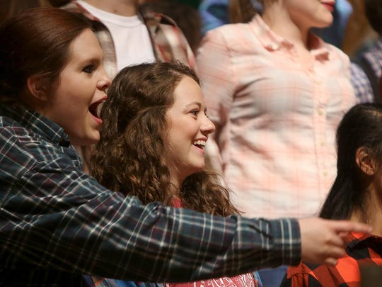 Madison Joyner, left, and Summer Miller smile during rehearsal Monday for the musical 'The River' in Hope Hall at Northside United Methodist Church.