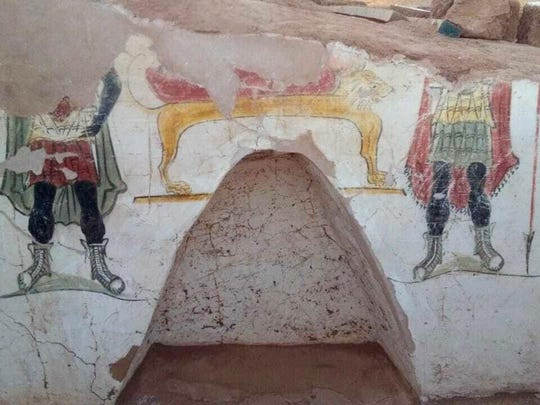 This undated handout photo from the Egyptian Antiquities Authority shows colorful funeral paintings in an ancient tomb dating back to the Roman period, at the Dakhla Oasis in the Western Desert, Egypt.