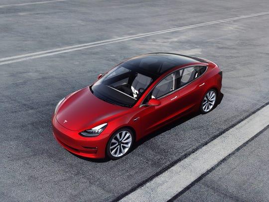 A red Tesla Model 3.