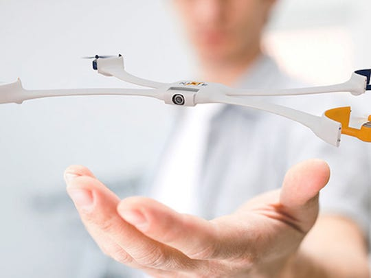 Nixie is a small, wearable drone for your wrist that can fly off and snap a photo of you from an aerial view.