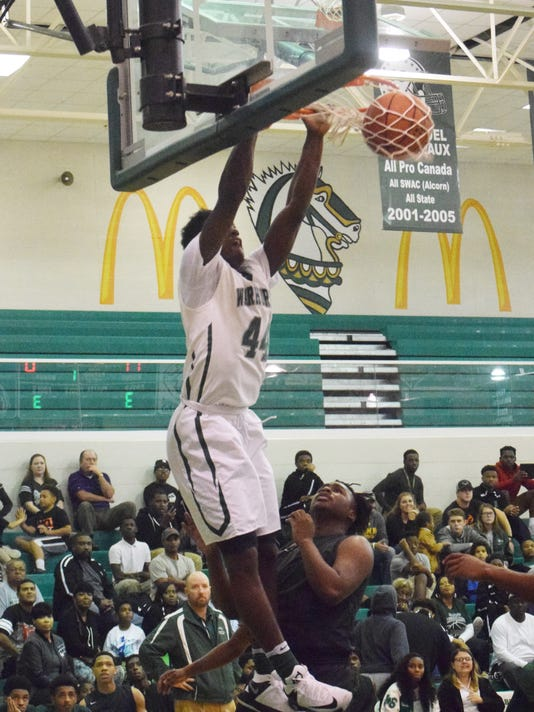 Peabody's Kevin Norman (44) scores two against Rapides.