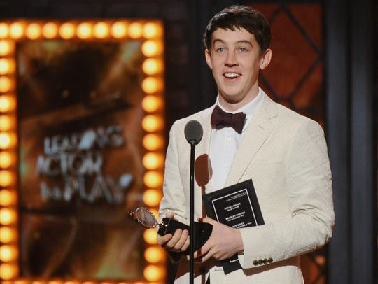 Alex Sharp accepts the award for best leading actor