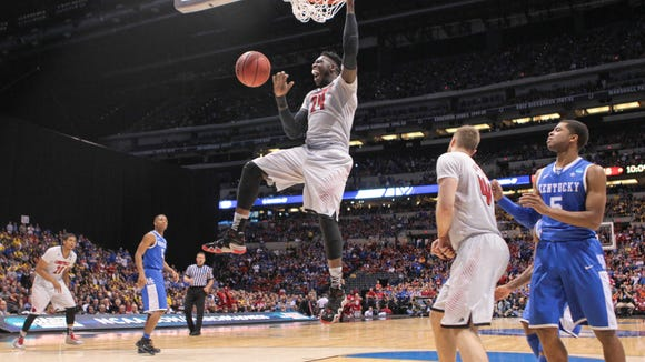 Louisville's Montrezl Harrell makes finishes an emphatic jam during the first half of Friday's game in Indianapolis.