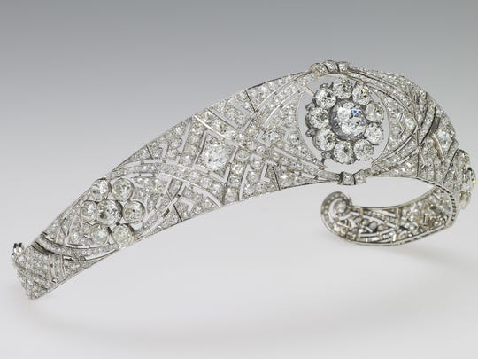 Queen Mary's Diamond Bandeau was specifically made for Queen Mary in 1932 to accommodate in the center the detachable brooch given as a present for her own wedding in 1893 by the County of Lincoln. The bandeau, chosen from Her Majesty's collection, is formed as a flexible band of eleven sections, pierced with interlaced ovals and set with large and small brilliant diamonds. The center is set with the detachable brooch of ten brilliant diamonds. The bandeau and the brooch were bequeathed by Queen Mary to The Queen in 1953.