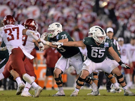 Michigan State Spartans offensive lineman Brian Allen (65) blocks during the fourth quarter against the Washington State Cougars in the 2017 Holiday Bowl at SDCCU Stadium.